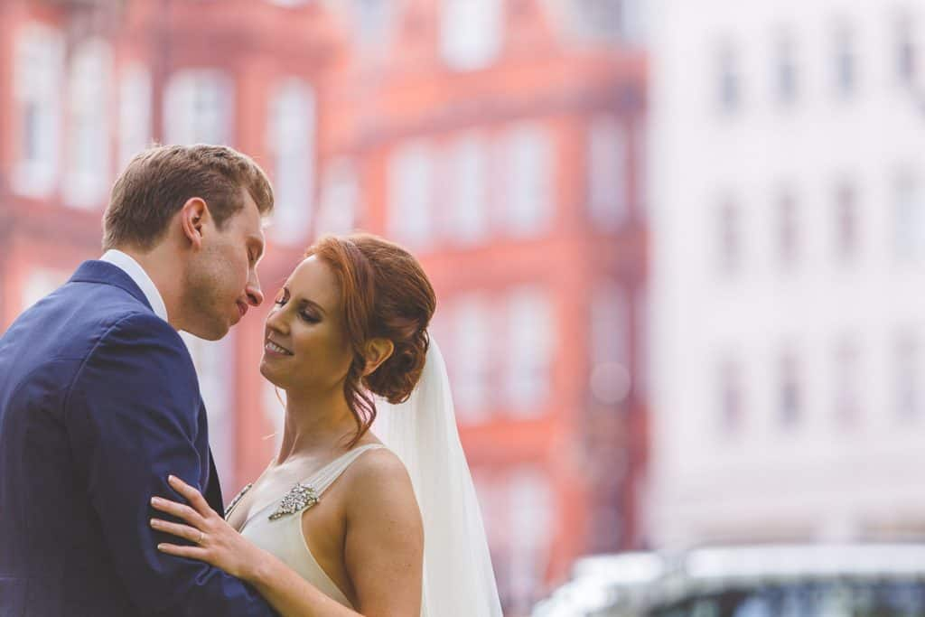 Emotional bride and groom portraits at Berkley Square Gardens