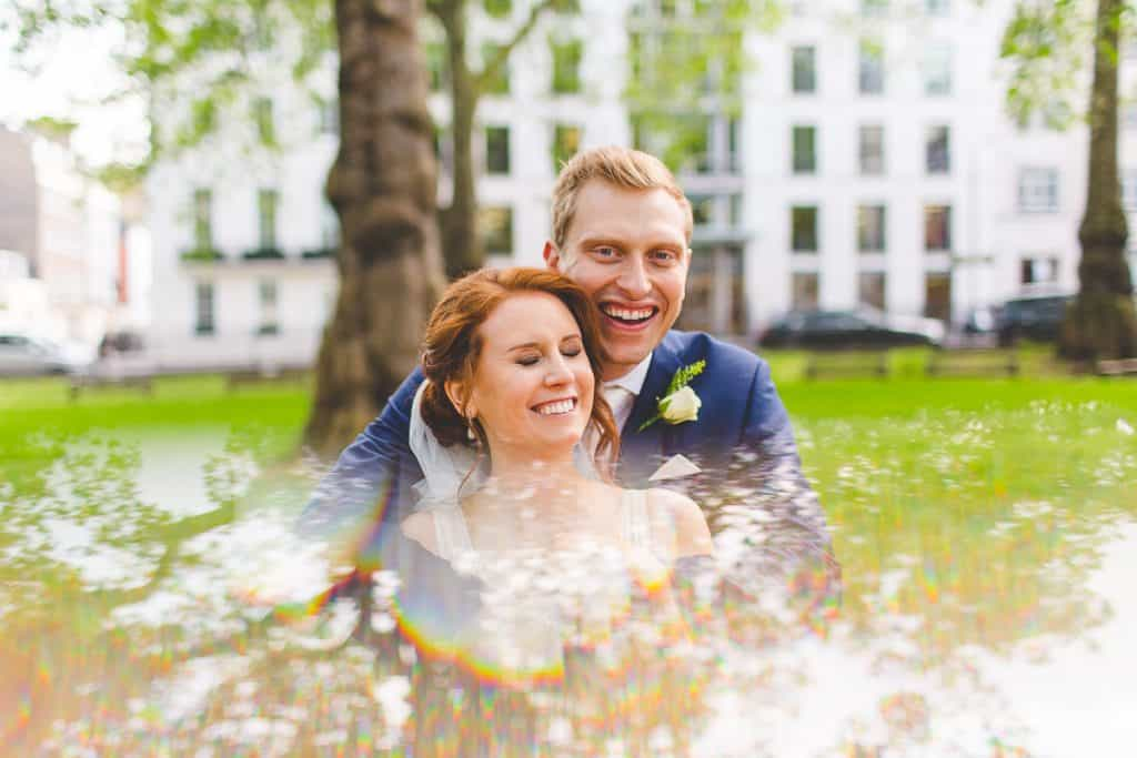 Fun bride and groom portraits at Berkley Square Gardens