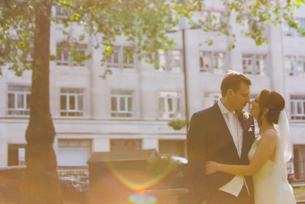 Fun bride and groom portraits at Berkley Square Gardens