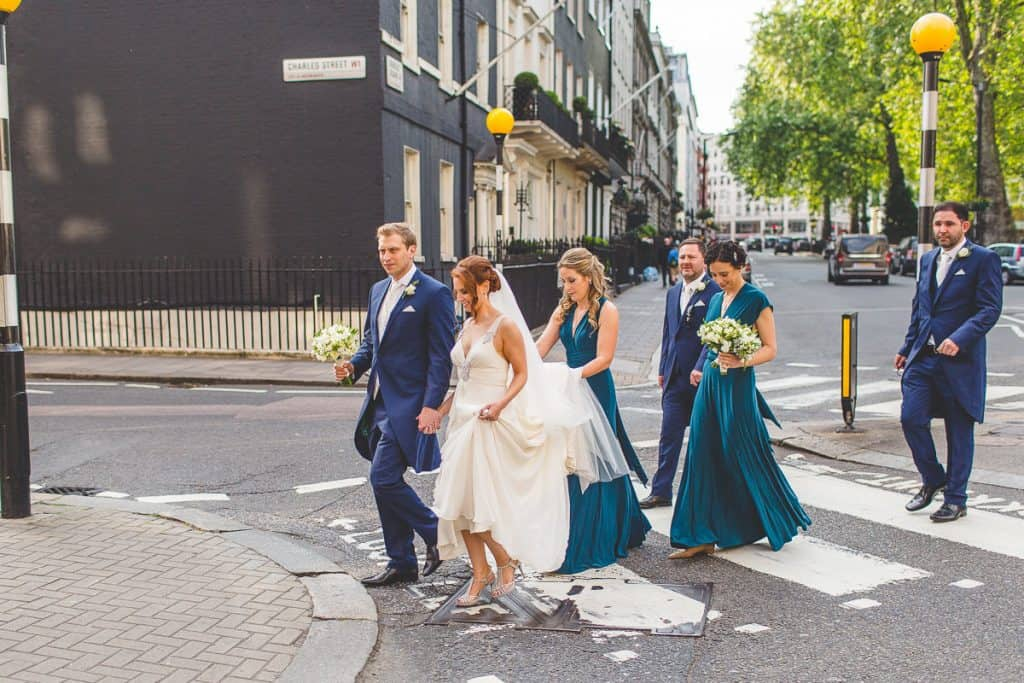 Bridal party walking through London