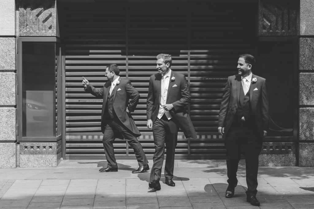 Groom and groomsmen having a laugh