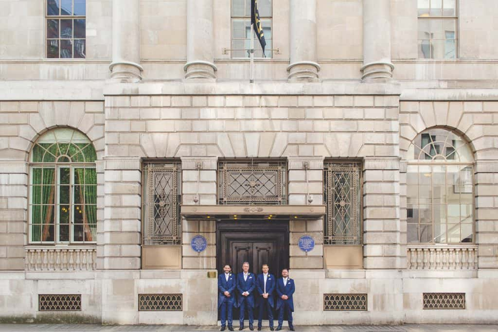 Groom and groomsmen outside Lansdowne Club, London